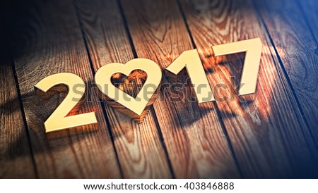 Lovely year 2017 is lined with gold letters on wooden planks. 3D illustration image - stock photo