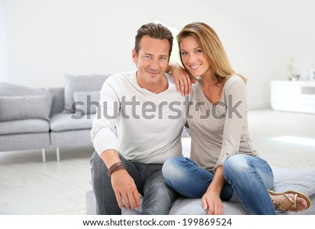 Lovely 40-year-old couple at home