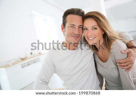 Lovely 40-year-old couple at home - stock photo