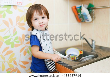 lovely 2 years baby washing dishes