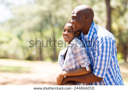 lovely young african couple at the park - stock photo