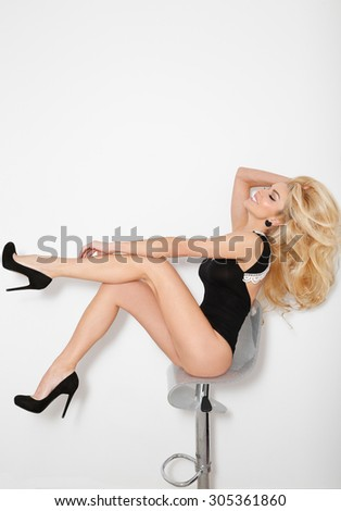 Lovely young blonde hair the woman are sitting on a chair in pyjamas sexy smiling