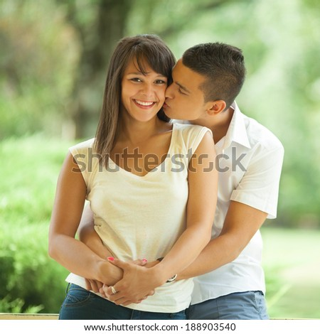 Lovely young couple embracing - stock photo