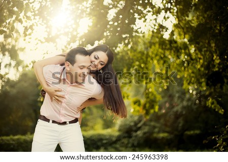 Lovely young couple in love outdoors - stock photo