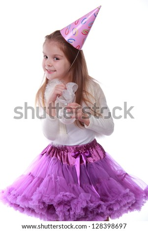 Lovely young girl holding decorative white ball isolated on white/Child dressed in bright festive clothes dancing