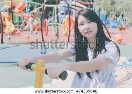 lovely young girl in the park , pastel color