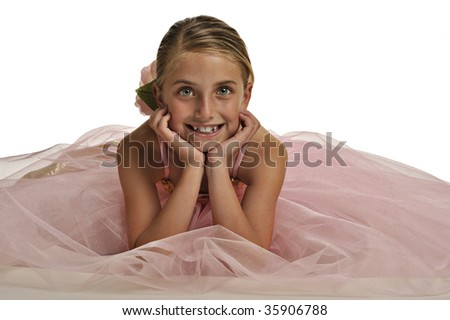 Lovely young girl poses in ballerina outfit