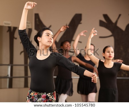 Lovely young Hispanic dance students practicing ballet - stock photo