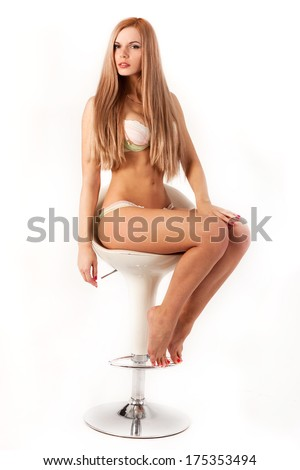 Lovely young lady sitting in a chair - stock photo