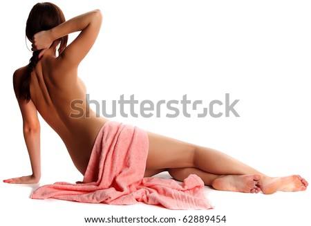 Lovely young nude woman with towel sit of back - stock photo