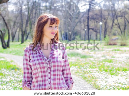 Lovely young spring woman , outdoor portrait , caucasian female in the park. - stock photo