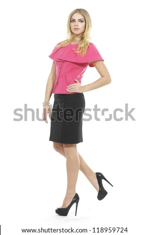 Lovely young woman in elegant clothing, white background - stock photo