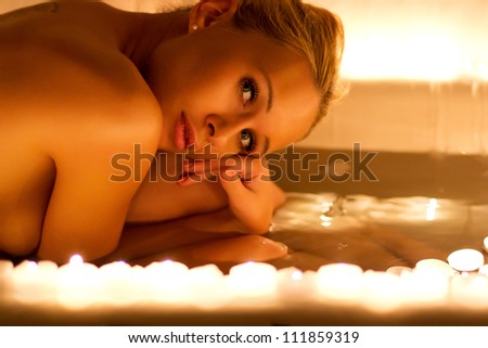 Lovely young woman relaxing in bathroom
