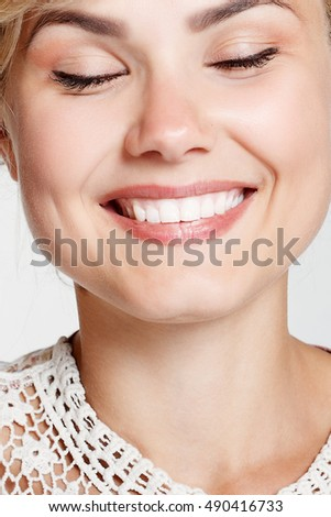Lovely young woman smiling . Happy blond young woman smiling, studio. white teeth, dentistry, prosthetics