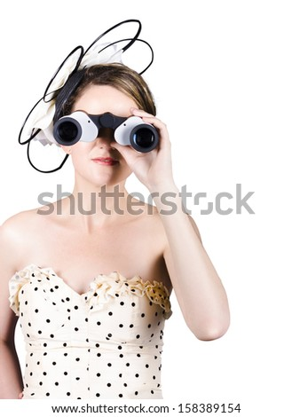 Lovely young woman watching horse racing looking through binoculars - stock photo