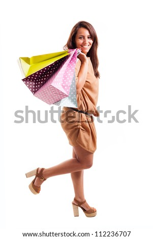 lovely young woman with shopping bags over white