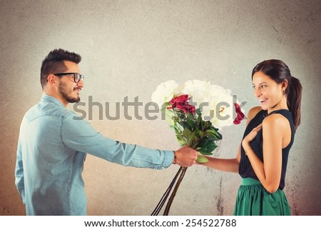 Lover boy gives flowers to his girlfriend - stock photo