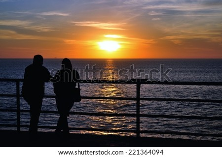 Lovers at Sun Set at Huntington beach, California, USA - stock photo
