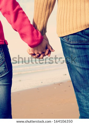 Lovers couple holding hands  - stock photo