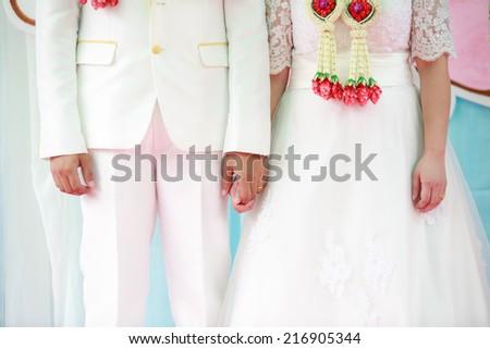 Lovers couple holding hands is enjoying wedding - stock photo