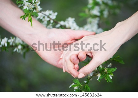 Lovers couple holding hands  (summer/spring) - stock photo
