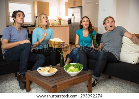 Lovers dating and neighbors together watching movies and sports games football soccer - stock photo