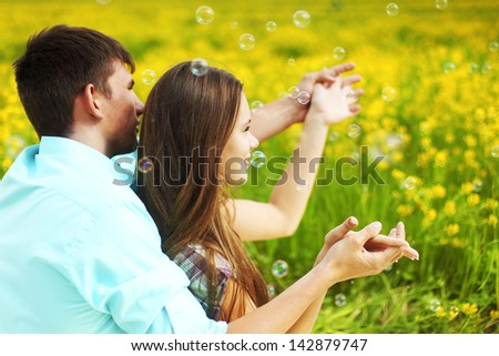 lovers hug on yellow flower field