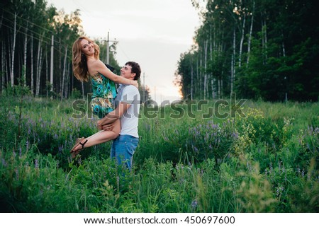 Lovers laughing in the summer park
