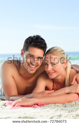 Lovers lying down on the beach