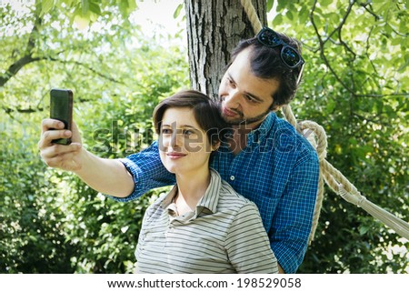 lovers making self portrait with cellphone outdor