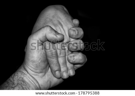 Lovers man and woman crossed hands in black and white