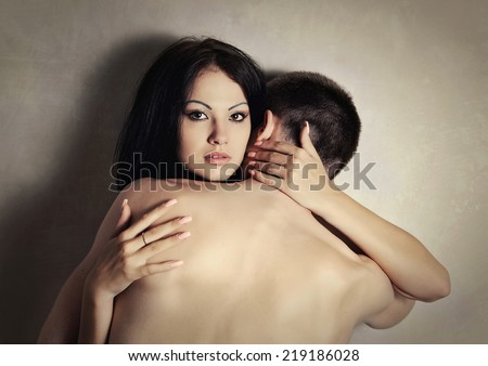 Lovers. Man and woman in love embracing. Sexy beauty couple. - stock photo