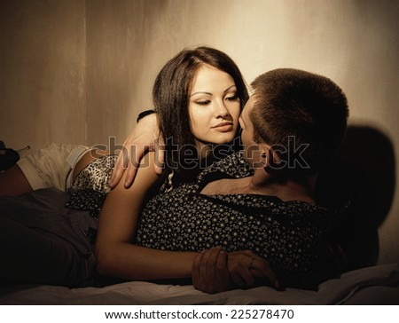 Lovers. Man and woman in the bed. Sexy beauty couple - stock photo