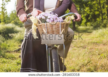 Lovers man and woman riding on vintage bicycle