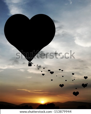 Lovers sowing hearts from a heart shape hot air balloon floating in a surreal sunset sky.  - stock photo