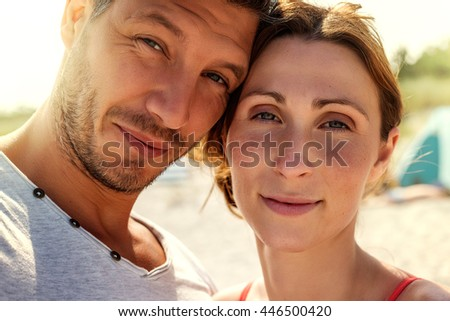 lovers sunlit portrait of man and woman - stock photo