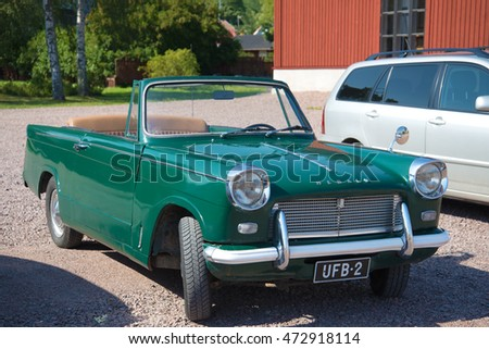 LOVIISA, FINLAND - AUGUST 20, 2016: Vintage car Triumph Herald 1200 Convertible on the streets of the city of Loviisa