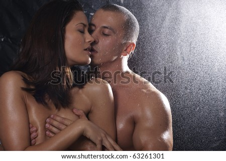 Loving affectionate nude heterosexual couple in shower hugging