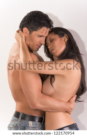 Loving affectionate nude multiethnic heterosexual couple in affectionate sensual hug. Mid adult Caucasian men in late 30s and young Asian woman in 20s