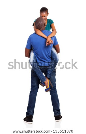 loving african husband lifting his wife on white background - stock photo
