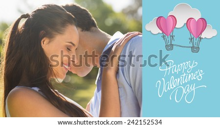 Loving and happy couple at park against cute valentines message - stock photo
