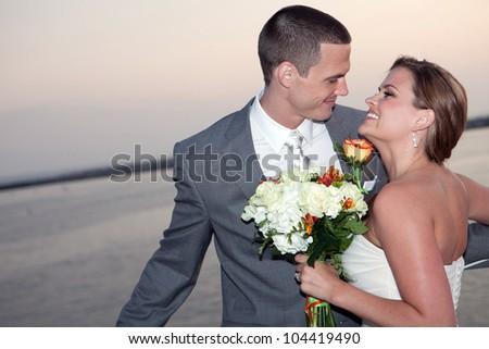 Loving beautiful bride and groom - stock photo