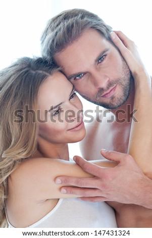 Loving beautiful couple isolated on white - portrait - stock photo