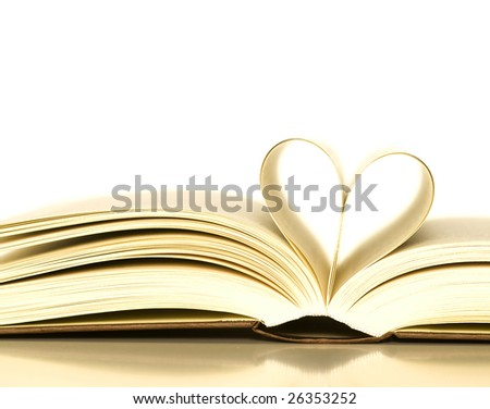 loving books (pages of book curved into a heart shape) - stock photo