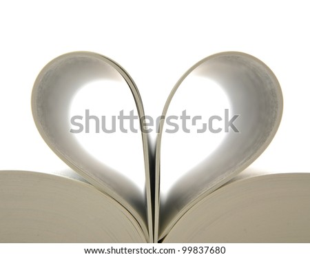 Loving books;pages of book curved into a heart shape - stock photo