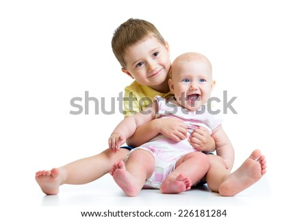 Loving brother and little sister hugging isolated on white - stock photo