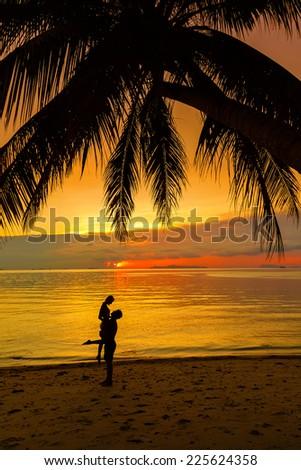 Loving couple at sunset - stock photo