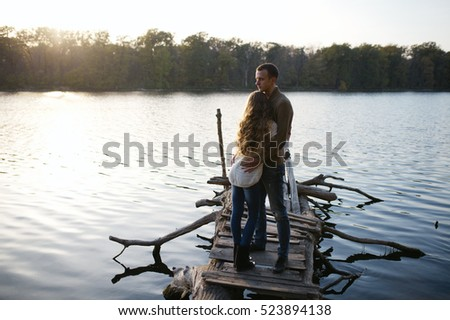 Loving couple at the lake, a love story, feeling beautiful, sunny and smiling, love