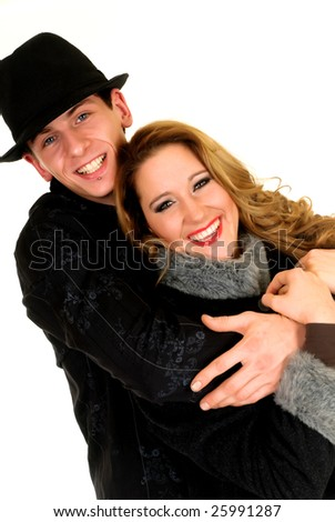 Loving couple, Attractive women with cap and winter coat, man with hat and piercing.  studio shot, white background