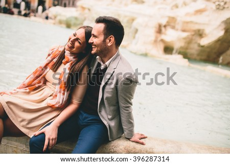 Loving couple by the Trevi fountain in Rome - stock photo